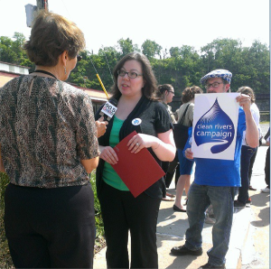 Clean Rivers Campaign Director Jennifer Rafanan Kennedy speaks to WESA prior to the press conference this morning. (Photo by Sara Powell)