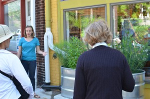 NMRWA employee, Sara explains how the stormwater planter at Biddle's Escape works.