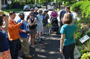 The tour stops at the permeable pavement, installed by Stormworks, on Trenton Avenue.